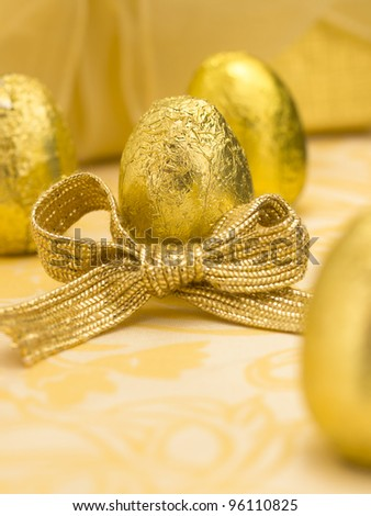 golden eggs with bow - stock photo