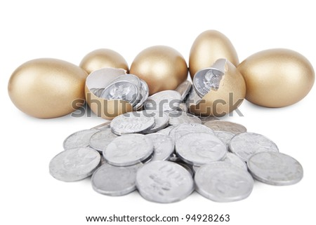 Golden eggs with coins on white background - stock photo