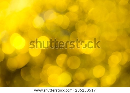 Golden festive Christmas background. Abstract with bright twinkles, sparkles, blurred, defocused light. - stock photo