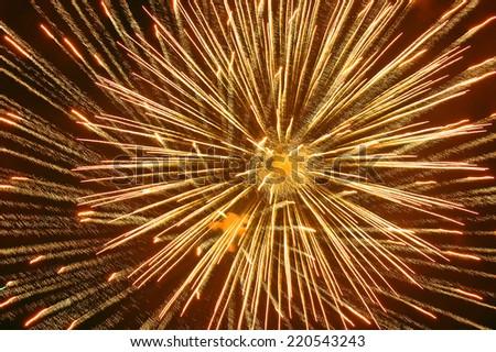 Golden fireworks explosion on black sky background - stock photo