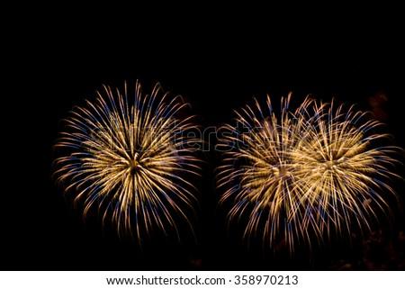 Golden Fireworks Finale.  Gold toned fireworks rockets against a black sky. - stock photo