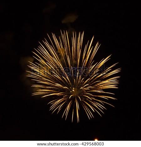 Golden fireworks on black background, Fireworks explode, fireworks background, light show, close-up - stock photo