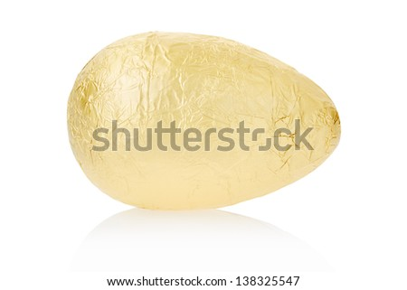 Golden foil egg isolated on white, clipping path included - stock photo