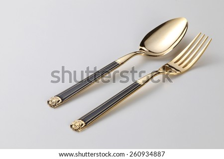 golden fork and spoon - stock photo