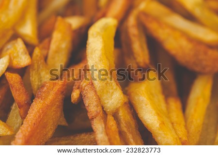 Golden French fries potatoes ready to be eaten. Slightly overcooked, that would be crispy - stock photo