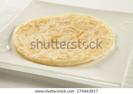 Golden fried paratha served on a hot plate - stock photo