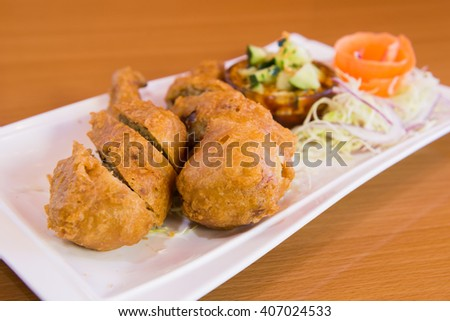 Golden fried stuffed chicken with plum sauce - stock photo
