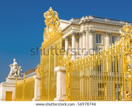 Golden gate and Palace facade in Versailles over blue sky. France - stock photo