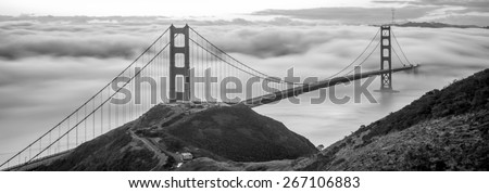 Golden Gate Bridge about to get engulfed with low fog - stock photo