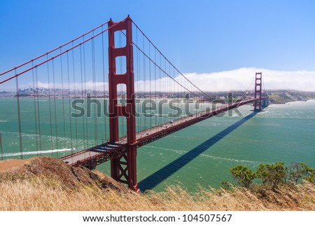 Golden Gate Bridge and fog covering San Francisco - stock photo