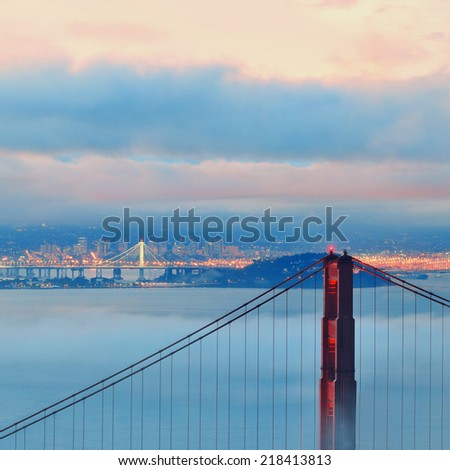 Golden Gate Bridge and fog in San Francisco - stock photo
