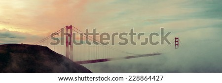 Golden Gate Bridge and fog panorama in San Francisco - stock photo