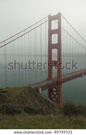Golden Gate Bridge and San Francisco Bay, during foggy morning - stock photo