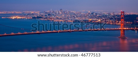 Golden Gate Bridge and San Francisco Skyline at Night Seen from Marine Headlands, California. - stock photo