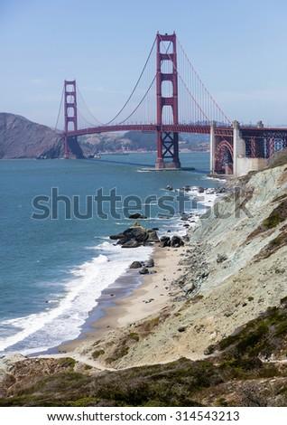 Golden Gate Bridge as seen across the beach and ocean - stock photo