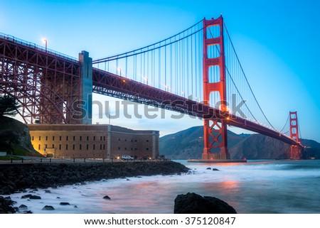 Golden Gate Bridge during sunset at Fort Point, San Francisco - stock photo