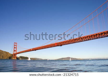 Golden Gate Bridge from the Pacific Ocean with sailboats in the bay - stock photo