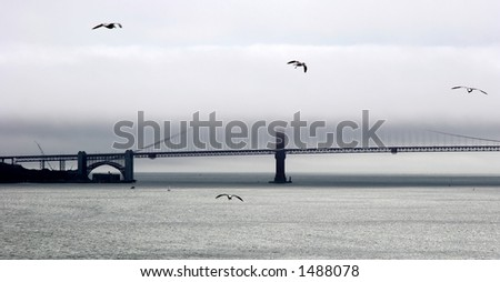 Golden Gate bridge in a fog. - stock photo
