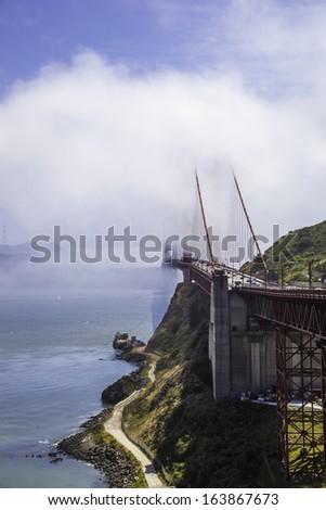 Golden Gate Bridge in fog - stock photo
