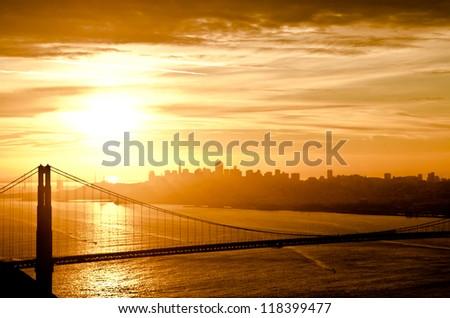 Golden Gate Bridge in San Francisco during sunrise - stock photo