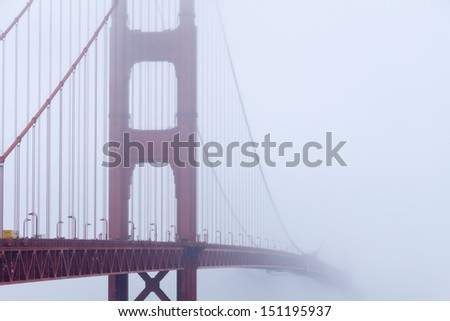 Golden gate bridge in the fog, San Francisco bay, California - stock photo
