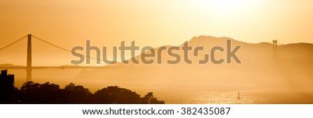 Golden Gate Bridge Panorama at Sunset in Gold - stock photo