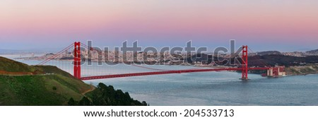 Golden Gate Bridge panorama at sunset in San Francisco as the famous landmark. - stock photo