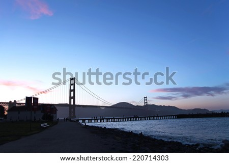 Golden Gate Bridge silhouette at dawn - stock photo