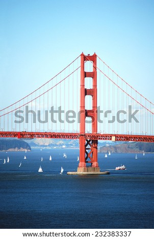 Golden Gate Bridge with boats - stock photo