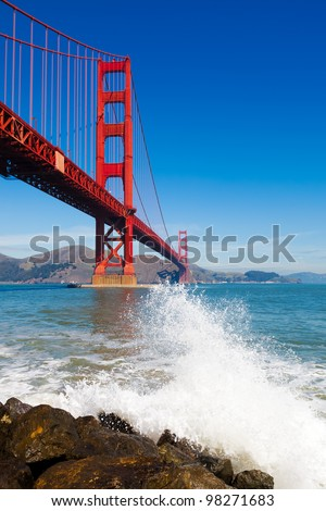 Golden Gate Bridge with spray from ocean wave - in San Francisco, California - stock photo