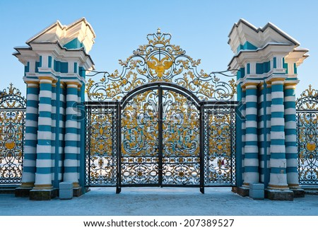 Golden gates of Catherine palace in Tsarskoe Selo, Russia - stock photo