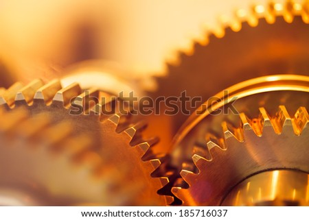 golden gear wheels, close-up - stock photo
