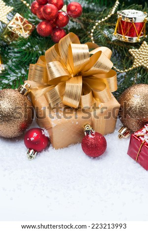 Golden gift box and Christmas tree decorations, vertical, top view - stock photo