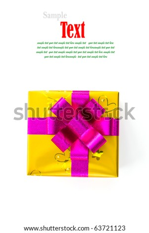 Golden gift box decorated with pink ribbon isolated on white background. - stock photo