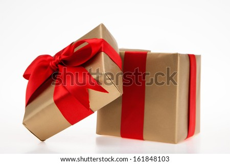 Golden gift box with red ribbon with top - stock photo