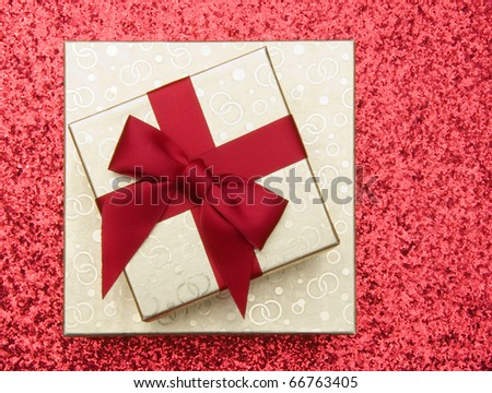 Golden gift boxes on red background - stock photo