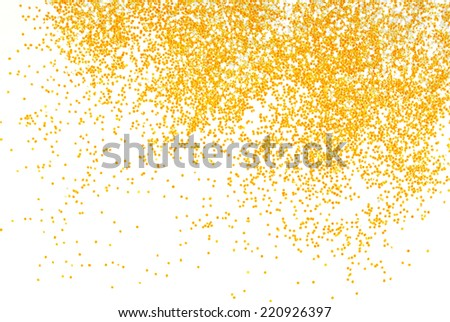 golden glitter sparkle on black background - stock photo