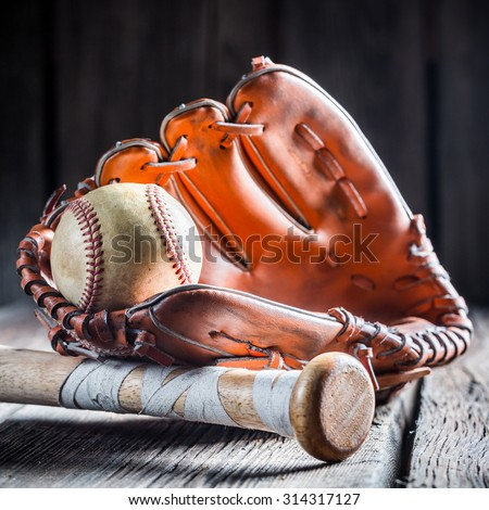 Golden glove and old baseball ball - stock photo