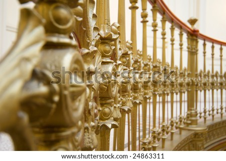 Golden handrail in a palace - stock photo