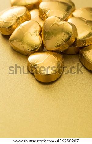 Golden heart-shaped chocolate - stock photo