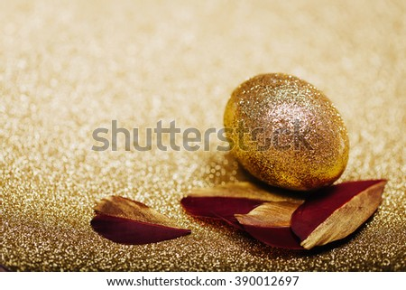 Golden Holiday Background with feather and easter egg - stock photo