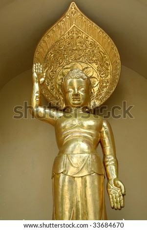Golden icon on exterior of Buddhist shrine in Darjeeling, West Bengal, India, Asia - stock photo