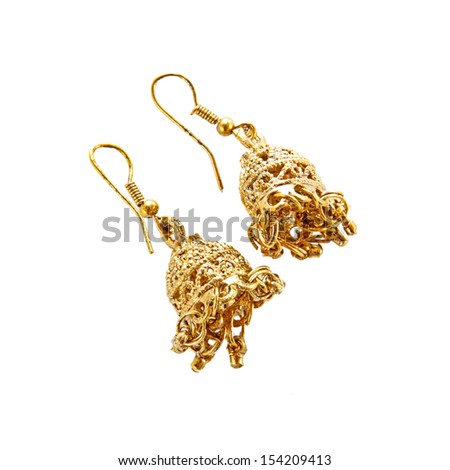 Golden indian traditional  indian earrings - stock photo