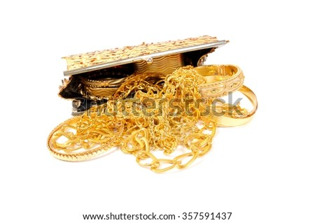 Golden jewels on white - stock photo