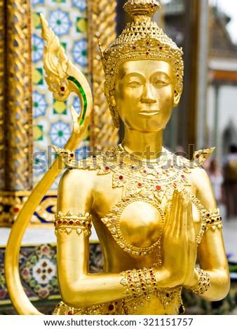 Golden Kinari statue at Grand Palace in Bangkok, Thailand. - stock photo