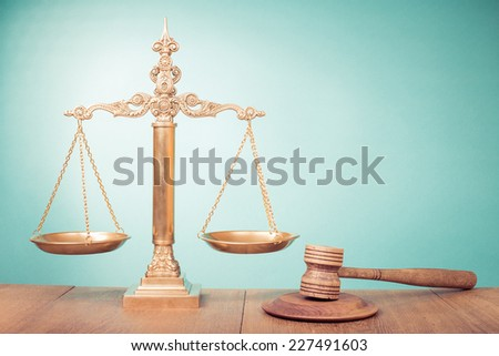 Golden Law scales and judge gavel. Symbol of justice - stock photo
