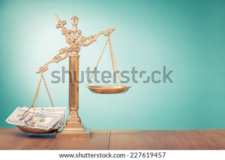 Golden Law scales with thousands dollars cash money - stock photo