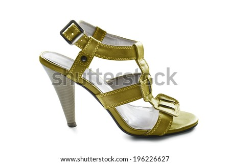 Golden leather high heeded sandal isolated over white - stock photo
