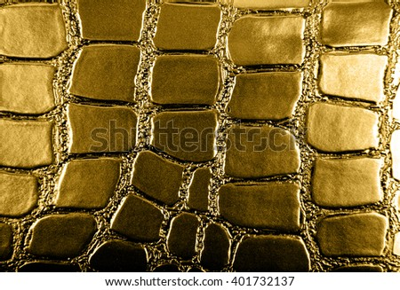 Golden leather texture as background closeup - stock photo