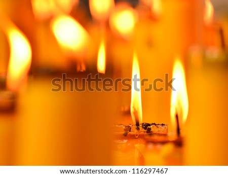 Golden light of candle flame in Chinese Vegetarian Festival - stock photo